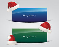 Set of Christmas banners, Santa Claus caps Royalty Free Stock Images