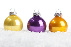 Set of christmas baubles in yellow, violett, orange Royalty Free Stock Photography