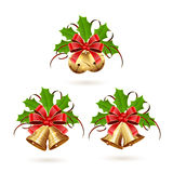 Set of Christmas bells with ribbon and holly berries Stock Image