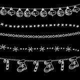 Set of christmas chalk doodle garlands, dividers on blackboard Royalty Free Stock Photos