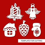 Set of christmas Decoration - silhouettes of Angel, candles, pine cone, mitten, hut small house. Template for laser cutting, wood carving, paper cut. Decor for Royalty Free Stock Photo