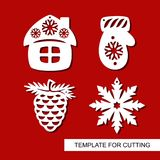 Set of christmas Decoration - silhouettes of pine cone, mitten, hut small house, snowflake. Template for laser cutting, wood carving, paper cut. Decor for xmas Royalty Free Stock Image