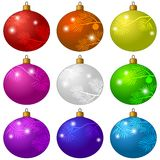 Set of Christmas decorations. Beautiful colorful glass balls with flashes and patterns of fir branches, isolated on white bacground Royalty Free Stock Image