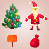 Set of Christmas elements from the plasticine: Santa, Christmas tree. Gift bag and plate Royalty Free Stock Photo