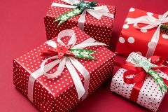 Set of Christmas Gift Boxes Christmas Background Holiday Decorations Presents in a Red Wrapper Red Background.  Stock Photo