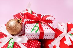 Set of Christmas Gift Boxes Christmas Background Holiday Decorations Presents in a Red Wrapper Pink Background.  Royalty Free Stock Photography