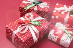 Set of Christmas Gift Boxes Christmas Background Holiday Decorations Presents in a Red Wrapper Red Background.  Royalty Free Stock Photo