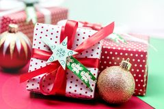 Set of Christmas Gift Boxes Christmas Background Holiday Decorations Presents in a Red Wrapper Red and Green Background Close Up.  Royalty Free Stock Photo