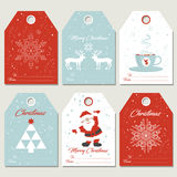 Set Christmas gift tags in retro style. Set Christmas gift tags with snowflakes, deers, cup of tea, Santa and Christmas tree in retro style Stock Photos