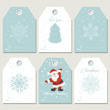 Set Christmas gift tags with snowflakes in retro style Royalty Free Stock Image