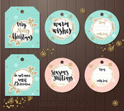 Set of Christmas gift tags with winter illustrations and wishes. Stock Images