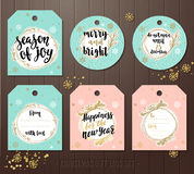 Set of Christmas gift tags with winter illustrations and wishes. Stock Photo