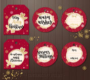 Set of Christmas gift tags with winter illustrations and wishes. Stock Photos