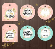Set of Christmas gift tags with winter illustrations and wishes. Royalty Free Stock Image