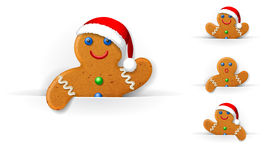 Set of Christmas gingerbread mans. Looks out from a horizontal white paper sheet Royalty Free Stock Images
