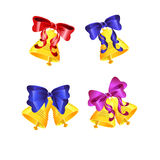Set of Christmas golden bells with red bows Stock Images