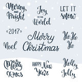Set of Christmas hand lettering elements. Holly Jolly. Let it snow. Joy to the World. Merry Christmas. Merry and Bright. Happy New. Set of Christmas hand Stock Photography