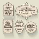 Set of Christmas and Happy New Year badges labels with clean modern styled design. Christmas decoration collection. Calligraphic and typographic elements Royalty Free Stock Image