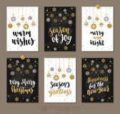 Set Christmas and Happy New Year greeting cards with handwritten brush calligraphy and decorative elements. Decorative vector illustration for winter Royalty Free Stock Photos
