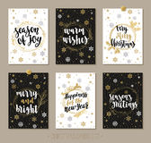 Set Christmas and Happy New Year greeting cards with handwritten brush calligraphy and decorative elements. Decorative vector illustration for winter Stock Images