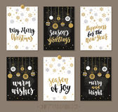 Set Christmas and Happy New Year greeting cards with handwritten brush calligraphy and decorative elements. Decorative vector illustration for winter Royalty Free Stock Photo