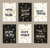Set Christmas and Happy New Year greeting cards with handwritten brush calligraphy and decorative elements. Decorative vector illustration for winter Stock Photos