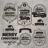 Set of Christmas and Happy New Year Labels with retro vintage styled design Stock Photography