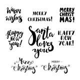 Set of Christmas and Happy New Year lettering. Design element for holiday design Stock Images