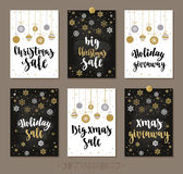 Set Christmas and Happy New Year sale and giveaway cards with handwritten brush calligraphy and decorative elements. Decorative vector illustration for winter Stock Photography