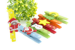 Set of christmas icon on colorful cloth clip. focus on teddy bear with santa claus costume Royalty Free Stock Photo