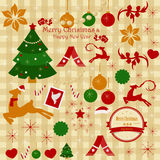 A set of Christmas items and ornaments on a plaid background Royalty Free Stock Images