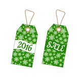 Set of Christmas labels with background from snowflakes Royalty Free Stock Image
