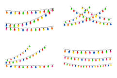Set of Christmas lights on white background Royalty Free Stock Image