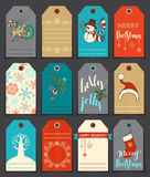 Set of 12 Christmas and New Year cute gift tags. Vector hand-drawn illustration. There is place for your text Stock Photos