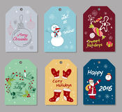 Set of Christmas and New Year gift tags. Set of hand drawn Christmas and New Year gift tags, small greeting cards with holidays attributes such as firtree balls Royalty Free Stock Photo