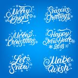 Set of Christmas and New Year 2018 quotes. Hand written lettering with falling snow and snowflakes. Royalty Free Stock Photography