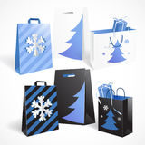 Set of Christmas and New Year shopping bags isolated on white ba Stock Photography