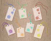 Set of Christmas paper tags on cord. With snowflakes. Royalty Free Stock Image