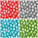Set Christmas patterns with gift boxes on a color. Background for textiles, interior design, for book design, website background Royalty Free Stock Images