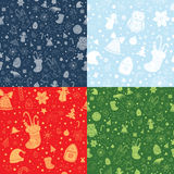 Set of Christmas Seamless backgrounds. Set of Christmas vector seamless patterns with christmas attributes. Silhouette and contour shapes on red, green and blue Royalty Free Stock Photo