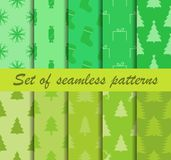Set of Christmas seamless patterns. Fir trees and celebratory symbols. Ten winter backgrounds. Vector royalty free illustration