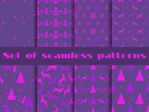 Set of Christmas seamless patterns with fir-trees, deer and snowflakes. Ultraviolet trend is the color of 2018. Vector Stock Photography