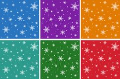 A set of Christmas seamless patterns with snowflakes. On colored backgrounds. Royalty Free Stock Photography