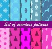 Set of Christmas seamless patterns. Sweets, gift boxes with toys. Ten winter backgrounds. Vector Stock Photography