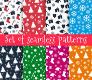 Set of christmas seamless patterns. Symbols of Christmas and win Stock Photos