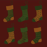 Set of Christmas socks with different patterns in orange and green colors. Vector Royalty Free Stock Photography