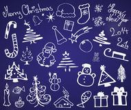 Set of Christmas symbols. Collection of drawn Christmas signs and symbols on a blue background Royalty Free Stock Photo