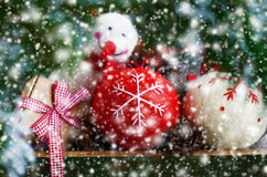 Set of christmas toys through out xmas fir tree twigs and snowflall Royalty Free Stock Image