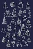Set of Christmas white trees isolated on dark background. Graphic design  for your design. Royalty Free Stock Images