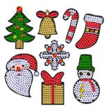Set of christmases patches with sequins.. Snowflake, candy, bell, Santa Stock Image